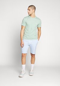 Calvin Klein - GARMENT FRONT LOGO - Teplákové kalhoty - blue - 1