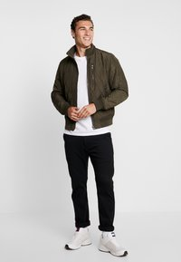 Tommy Hilfiger - DIAMOND QUILTED BOMBER - Light jacket - green - 1