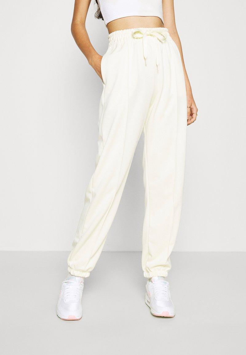 Nike Sportswear - TREND PANT - Tracksuit bottoms - coconut milk