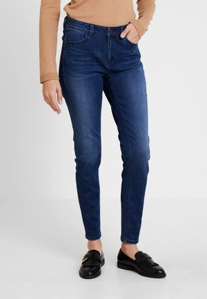 TROUSERS - Slim fit jeans - blue denim