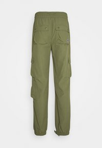 Russell Athletic Eagle R - ADMIRAL UNISEX - Cargo trousers - four leav clover - 1
