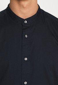 Calvin Klein - STAND COLLAR LIQUID TOUCH - Shirt - blue - 4