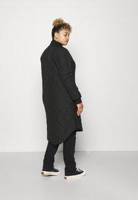 ONLY Carmakoma - CARCARROT NEW LONG QUILTED JACKET - Classic coat - black - 2