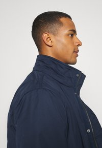 Tommy Jeans - TECH BOMBER UNISEX - Winter jacket - twilight navy - 8