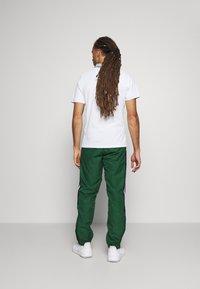 Lacoste Sport - Spodnie treningowe - green - 2