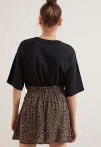 Tezenis - Shorts - nero/phard st.new animalier - 1