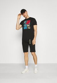 TOM TAILOR DENIM - REGULAR FIT - Denim shorts - black denim - 1