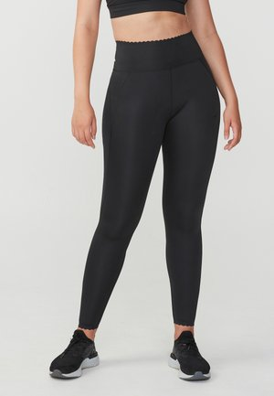 LASER CUT T - Leggings - black