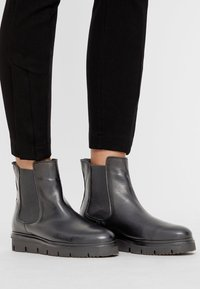 Bianco - CLEATED  - Platform ankle boots - black - 0