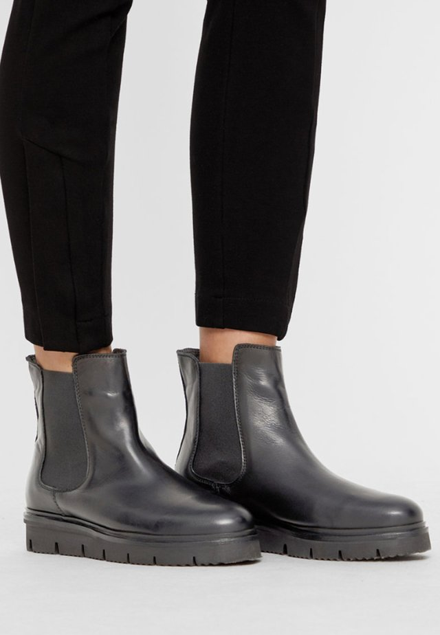 CLEATED CHELSEA  - Platform ankle boots - black