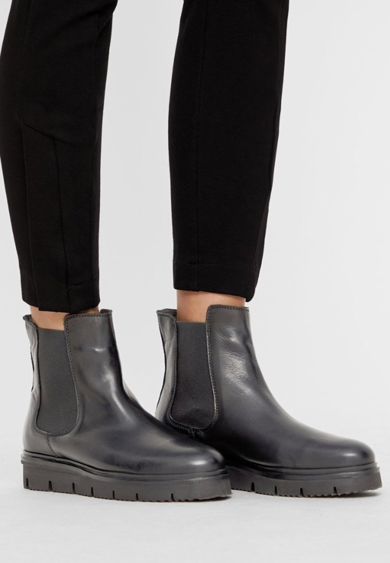 Bianco - CLEATED  - Platform ankle boots - black