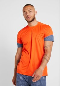 adidas Performance - TEE  - Print T-shirt - orange - 0