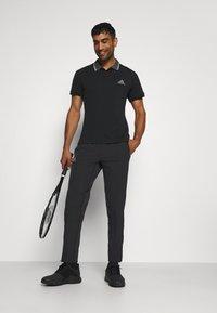adidas Performance - TENNIS PANT - Verryttelyhousut - black/grey - 1