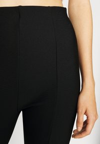 Gina Tricot - FRONT SLIT TROUSERS - Trousers - black - 5