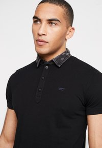 Diesel - T-MILES-NEW POLO SHIRT - Polotričko - black - 3