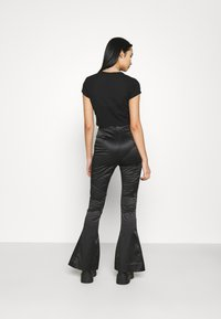 Weekday - ALECIO FLARE TROUSER - Trousers - black - 2