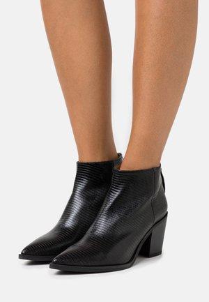 MIRTE - Ankle boots - black