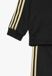 adidas Performance - SHINY  - Tracksuit - black/gold - 4