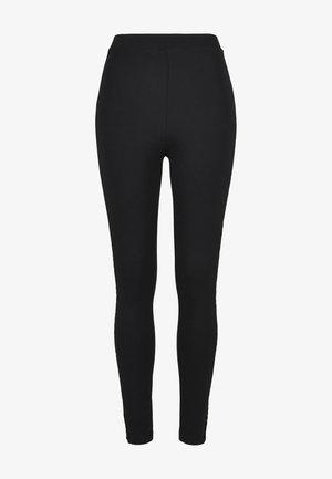 FLOCK LACE STRIPE - Leggings - Trousers - black