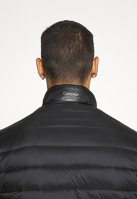 Calvin Klein - LIGHT WEIGHT SIDE LOGO JACKET - Light jacket - black - 4
