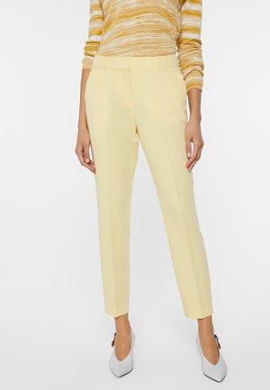 Pantalones chinos - light yellow