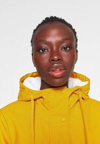 ONLY Tall - ONLSALLY RAINCOAT - Parka - golden yellow - 3