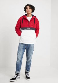 Tommy Jeans - COLORBLOCK POPOVER - Light jacket - red - 1