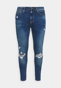 PHOENIX RIPS - Jeans Tapered Fit - mid blue