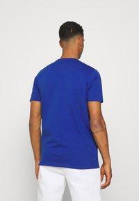 Ellesse - TRISCIA TEE - T-shirt z nadrukiem - blue - 2