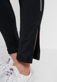 Nike Performance - ELITE TRACK PANT AIR - Træningsbukser - black/white - 7