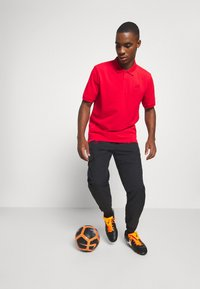 Nike Performance - FC LIVERPOOL PANT - Tracksuit bottoms - black/hyper turquoise/university red - 3