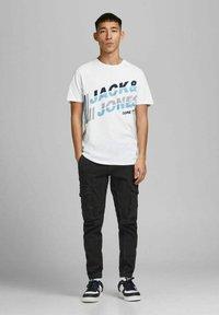 Jack & Jones - JCOALPHA TEE - Print T-shirt - white - 1