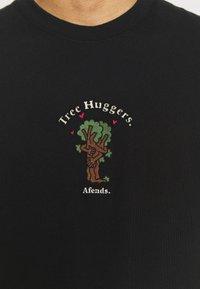 Afends - UNISEX TREE HUGGERS TEE - Print T-shirt - raven - 6