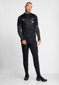 Nike Performance - DRY STRIKE PANT - Tracksuit bottoms - black/anthracite - 1