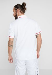 Lacoste Sport - Funktionströja - white/red - 2
