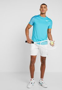 Mizuno - FLEX SHORT - Sports shorts - white - 1
