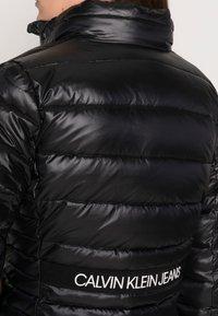 Calvin Klein Jeans - BACK LOGO ELASTIC MOTO JACKET - Winter jacket - black - 4