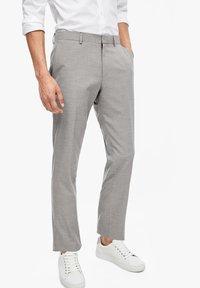 s.Oliver BLACK LABEL - Suit trousers - brown melange - 0