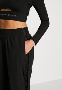 adidas by Stella McCartney - Outdoor trousers - black - 3