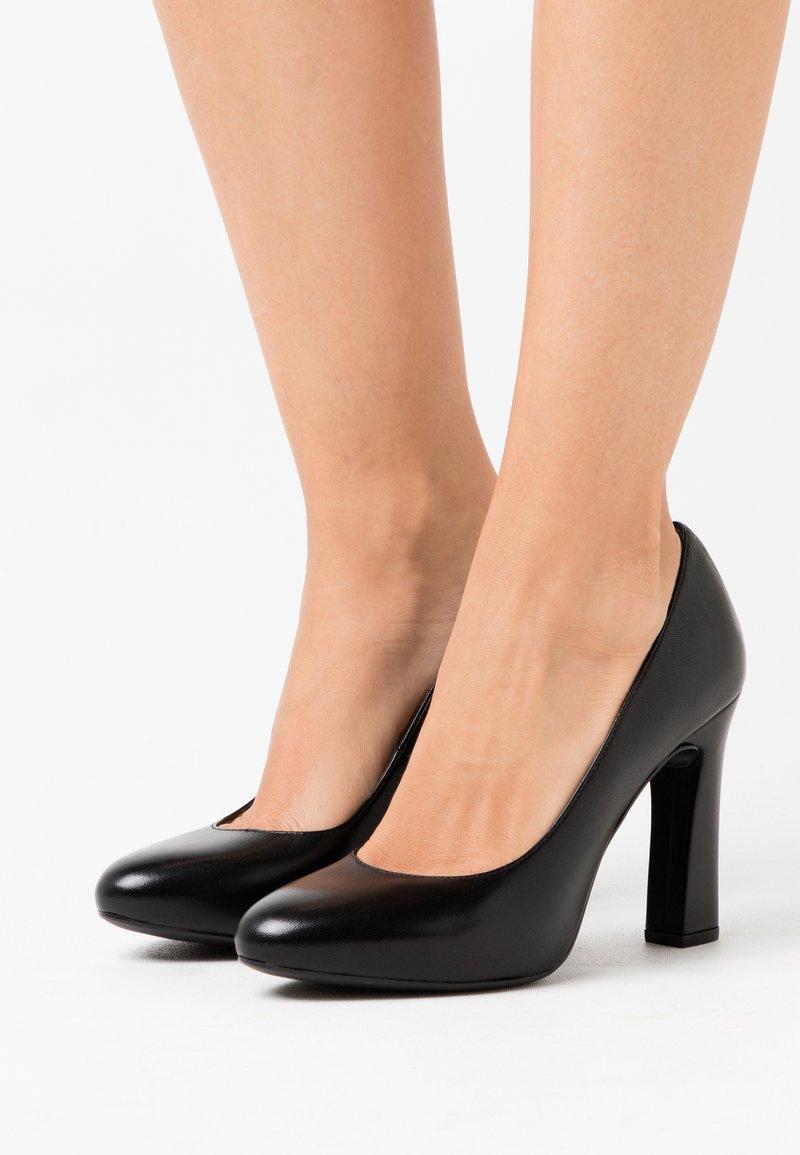 Unisa - PATRIC - Lodičky na vysokém podpatku - black