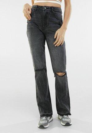 MIT RISSEN 00053534 - Flared Jeans - black