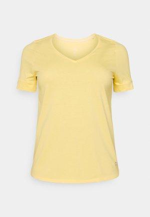 CUFF DETAIL - Print T-shirt - mellow yellow