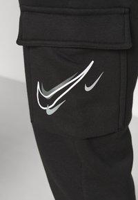 Nike Sportswear - CARGO PANT - Träningsbyxor - black - 4