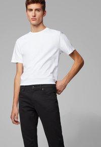 BOSS - MAINE - Straight leg jeans - black - 3