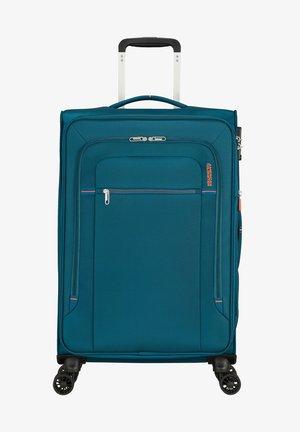 CROSSTRACK TROLLEY - Wheeled suitcase - navy/orange