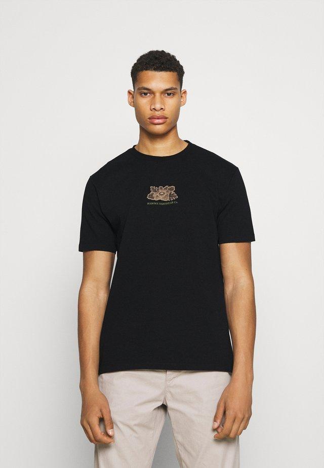 HARMONIA UNISEX - Camiseta estampada - black