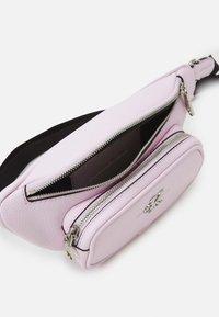 Calvin Klein Jeans - CONVERTIBLE WAIST BAG - Bum bag - pink - 3
