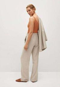 Mango - FLOWY STRAIGHT-FIT  - Trousers - ecru - 2