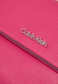 Calvin Klein - FLAP MINI BAG TOP HANDLE - Handbag - cerise - 3