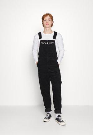 RETRO DUNGAREE UNISEX - Trousers - black